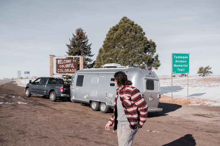 Airstream parked beside Colorado sign