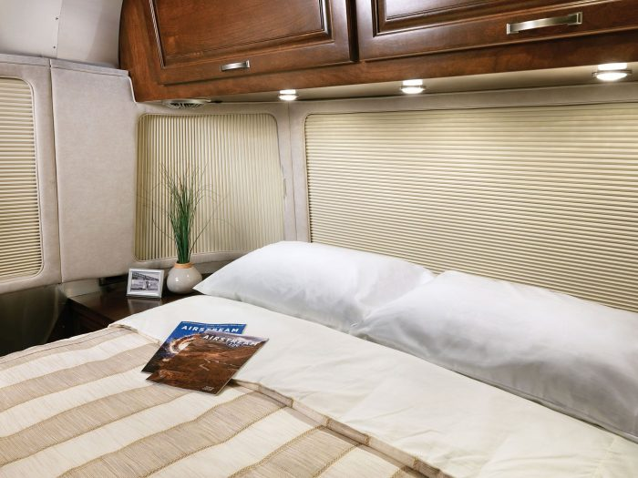 Interior of Airstream's 33-foot Classic travel trailer. Airstream and Oceanair worked to design a window treatment solution for the travel trailer's curving, panoramic windows.