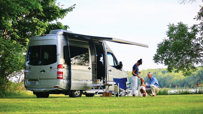 Airstream Interstate Nineteen Mercedes Benz lawn awning people