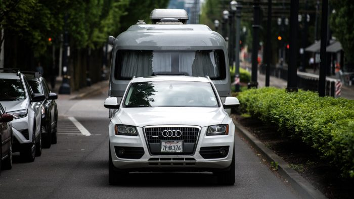 Airstream Travel Trailer small SUV small travel trailer towing Audi city bushes