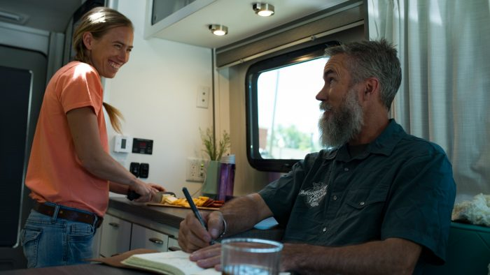 Nest by Airstream interior cooking writing man woman