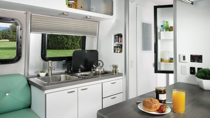 Nest by Airstream clutch blue interior floor plan galley cooking