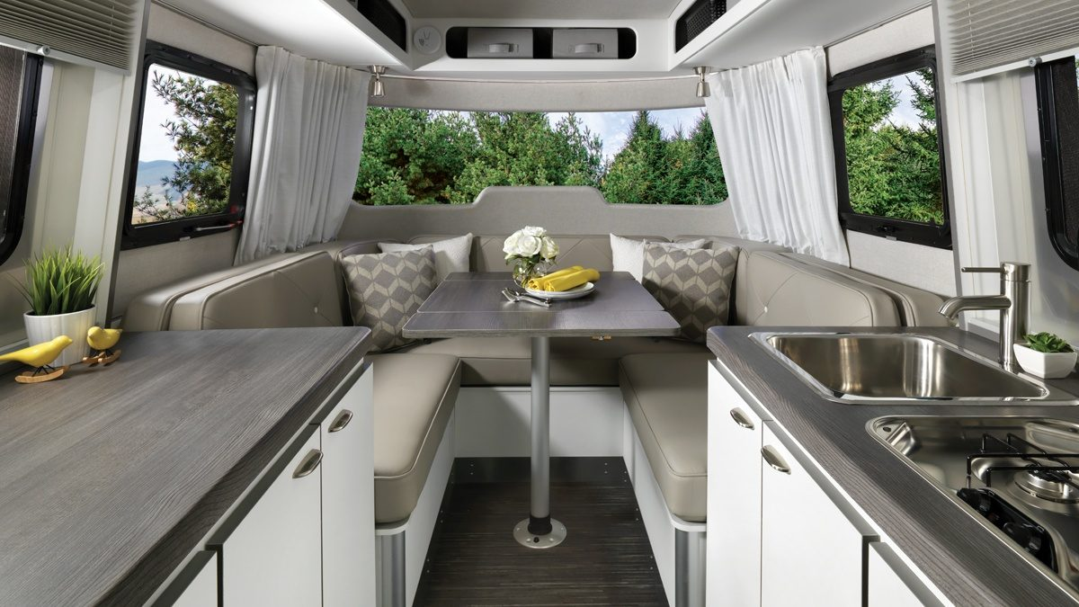 Nest by Airstream table seat kitchen stove storage interior
